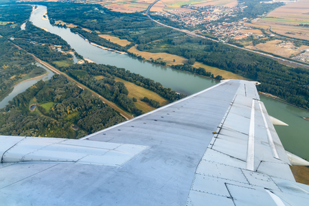 airplane wing: Airplane Wing On The Window With Landscape View Stock Photo