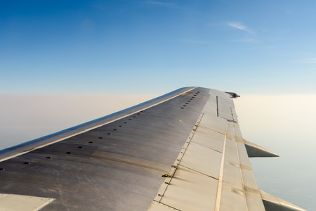 airplane wing: Window View Of Airplane Wing Flying Above Clouds