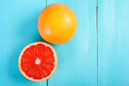 Fresh Red Grapefruit Slice On Wood Table