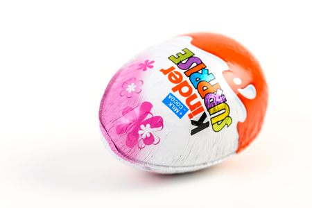 chocolate egg: BUCHAREST, ROMANIA - DECEMBER 02, 2015: Kinder Surprise Chocolate Eggs are a confection manufactured by Ferrero company and has the form of a chocolate egg containing a small toy.