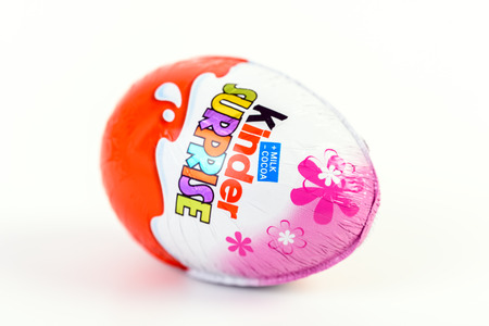 chocolate eggs: BUCHAREST, ROMANIA - DECEMBER 02, 2015: Kinder Surprise Chocolate Eggs are a confection manufactured by Ferrero company and has the form of a chocolate egg containing a small toy.