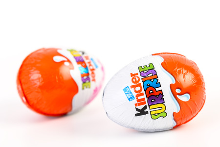 BUCHAREST, ROMANIA - DECEMBER 02, 2015: Kinder Surprise Chocolate Eggs are a confection manufactured by Ferrero company and has the form of a chocolate egg containing a small toy. Stok Fotoğraf - 53643998