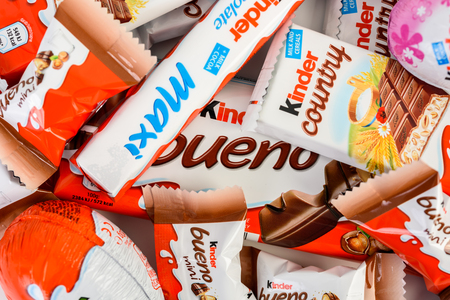 ferrero: BUCHAREST, ROMANIA - DECEMBER 04, 2015: Kinder Chocolate is a confectionery product brand line of Italian confectionery multinational Ferrero.