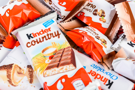 kinder: BUCHAREST, ROMANIA - DECEMBER 04, 2015: Kinder Chocolate is a confectionery product brand line of Italian confectionery multinational Ferrero.