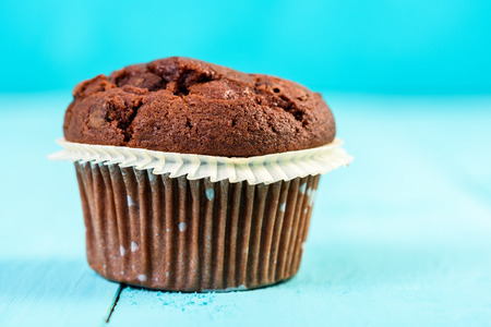 choco chips: Homemade Chocolate Chip Muffin On Blue Table