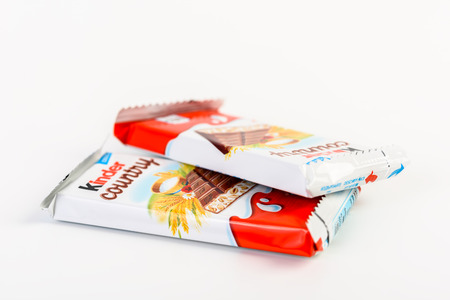 ferrero: BUCHAREST, ROMANIA - DECEMBER 02, 2015: Kinder Country Chocolate is a confectionery product brand line of Italian confectionery multinational Ferrero.