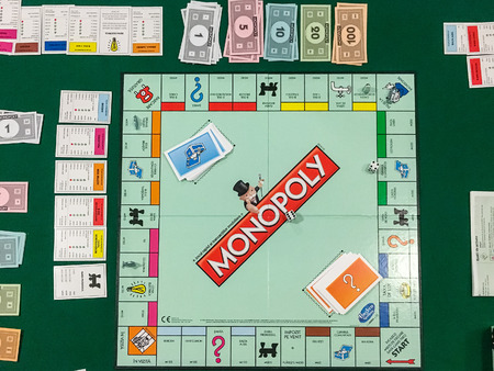 monopoly money: BUCHAREST, ROMANIA - JANUARY 01, 2016: Monopoly is a board game that originated in the United States in 1903 and the current version was first published by Parker Brothers in 1935.