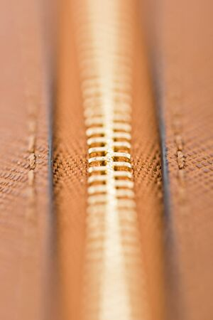 brown leather: Zipper Closeup On Brown Leather Wallet Stock Photo