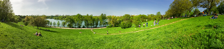 bucharest: BUCHAREST , ROMANIA - APRIL 17, 2016: Panorama View Of People Relaxing And Having Picnic In Youths Public Park (Parcul Tineretului) In Bucharest In First Days Of Spring.
