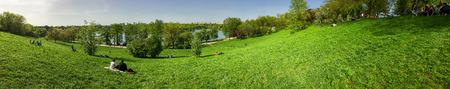 BUCHAREST , ROMANIA - APRIL 17, 2016: Panorama View Of People Relaxing And Having Picnic In Youths Public Park (Parcul Tineretului) In Bucharest In First Days Of Spring.