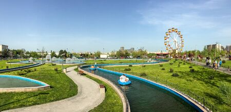 bucharest: BUCHAREST, ROMANIA - APRIL 17, 2016: Panorama View Of People Having Fun In Youths Public Amusement Park (Tineretului Park) In Bucharest.