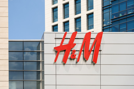 retailer: BUCHAREST, ROMANIA - MAY 13, 2015: Hennes & Mauritz (H&M) is a Swedish retail-clothing company and is ranked the second global clothing retailer in the world.