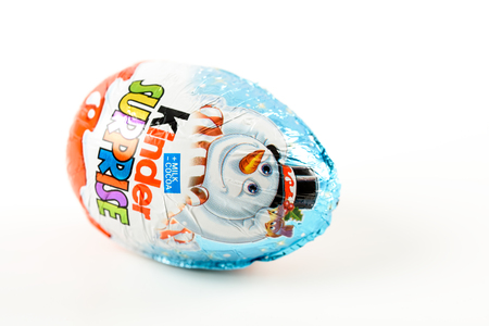 chocolate egg: BUCHAREST, ROMANIA - JANUARY 05, 2016: Kinder Surprise Chocolate Eggs are a confection manufactured by Ferrero company and has the form of a chocolate egg containing a small toy.