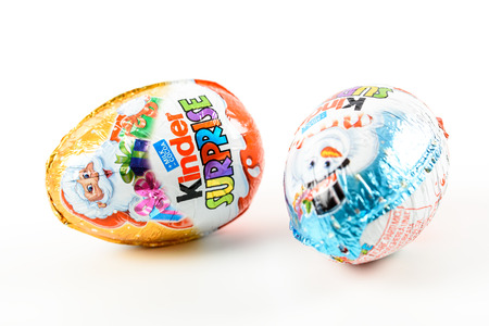 chocolate eggs: BUCHAREST, ROMANIA - JANUARY 05, 2016: Kinder Surprise Chocolate Eggs are a confection manufactured by Ferrero company and has the form of a chocolate egg containing a small toy.
