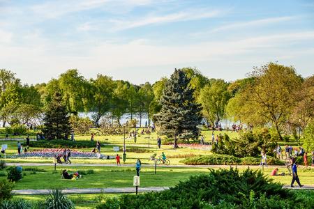 BUCHAREST, ROMANIA - APRIL 16, 2016: People Having Fun In Herastrau Public Park On Spring Day. Editorial
