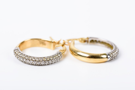 ear ring: Gold Earrings With Diamonds On White Stock Photo