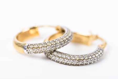 earrings: Gold Earrings With Diamonds On White Stock Photo