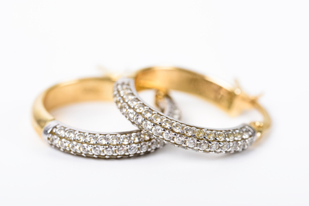 ear rings: Gold Earrings With Diamonds On White Stock Photo
