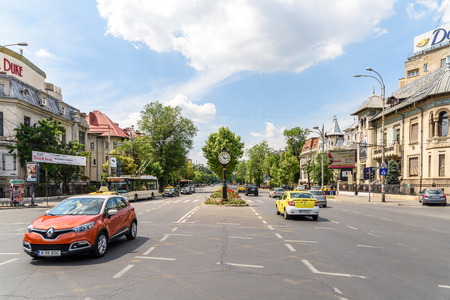 romana: BUCHAREST, ROMANIA - MAY 29, 2016: The Roman Square (Piata Romana) is one of the busiest and largest traffic intersections in downtown of Bucharest city. Editorial