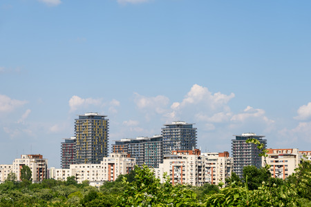 city park skyline: Bucharest City Skyline View Over Central Public Park Trees Stock Photo