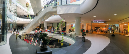 BUCHAREST, ROMANIA - MAY 30, 2016: Panoramic View Of People Crowd Rush In Shopping Luxury Mall Interior.