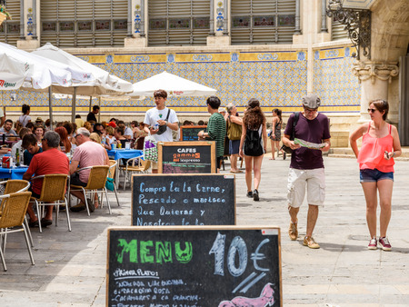 mercado central: VALENCIA, SPAIN - JULY 20, 2016: Tourists Having Lunch At Outdoor Restaurant Downtown Mercat Central (Mercado Central or Central Market) Square.