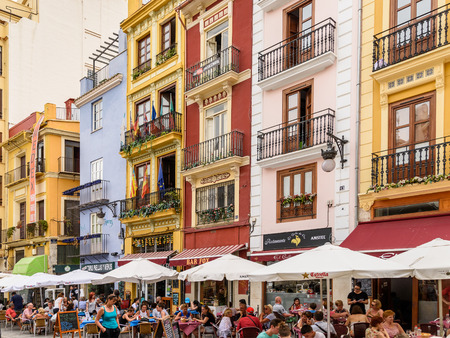 outdoor restaurant: VALENCIA, SPAIN - JULY 20, 2016: Tourists Having Lunch At Outdoor Restaurant Downtown Mercat Central (Mercado Central or Central Market) Square.