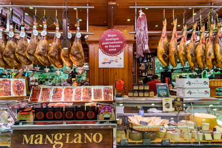 mercado central: VALENCIA, SPAIN - JULY 20, 2016: Vendors Selling Ham, Bacon And Meat Products In Mercado Central (Mercat Central or Central Market), One Of The Largest Market Places In Valencia.