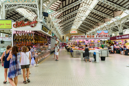 mercat: VALENCIA, SPAIN - JULY 20, 2016: From 1928 Mercado Central or Mercat Central (Central Market) is a public market located in across from the Llotja de la Seda and church of Juanes in downtown Valencia.