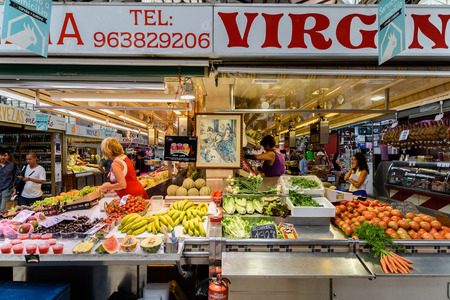 mercado central: VALENCIA, SPAIN - JULY 20, 2016: Vendors Selling Fresh Fruits In Mercado Central (Mercat Central or Central Market), One Of The Largest Market Places In Valencia.