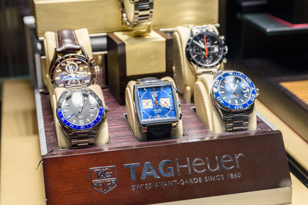 shop window display: VALENCIA, SPAIN - JULY 20, 2016: Luxury Watches For Sale In Shop Window Display.