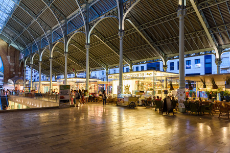 rehabilitated: VALENCIA, SPAIN - JULY 20, 2016: From 1916 Mercado Colon is an old market located in the city of Valencia now rehabilitated and equipped with shops and modern restaurants.
