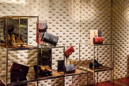 VALENCIA, SPAIN - JULY 22, 2016: Luxurious Woman Clothing And Accessories For Sale In Store Window Display.