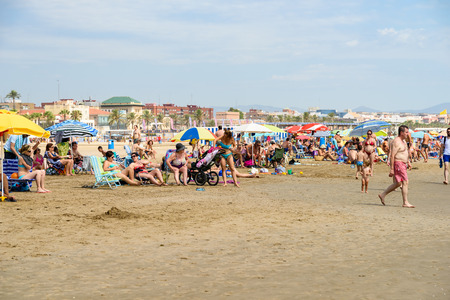 have fun: VALENCIA, SPAIN - JULY 23,  2016: People Have Fun At Balearic Sea On Valencia Beach In Summer. Editorial