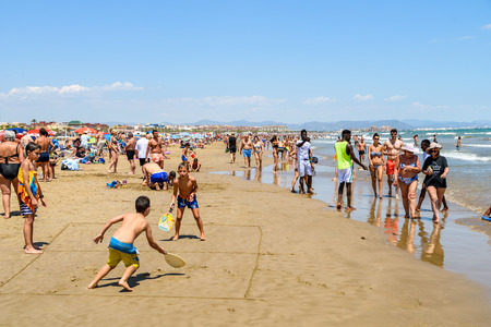 fun day: VALENCIA, SPAIN - JULY 23,  2016: People Have Fun At Balearic Sea On Valencia Beach In Summer. Editorial