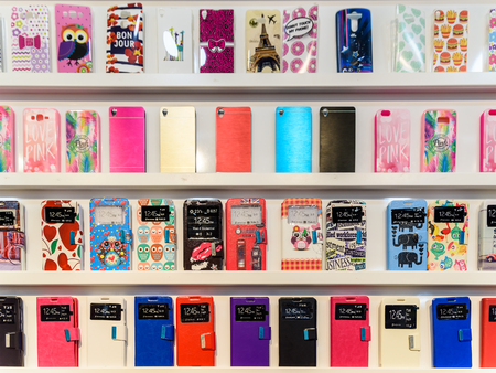 VALENCIA, SPAIN - JULY 23, 2016: Colorful iPhone And Samsung Phone Cases For Sale In Mobile Phones Stores.