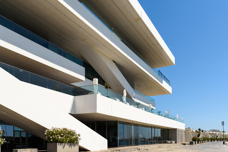 america's cup america: VALENCIA, SPAIN - JULY 24, 2016: Designed by the British architect David Chipperfield, Americas Cup Building (Veles e Vents) is located in Port of Valencia and won numerous architectural prizes.