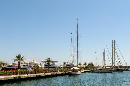 america's cup america: VALENCIA, SPAIN - JULY 25, 2016: People Boat Ride In Marina Real Juan Carlos Port Of Valencia City.