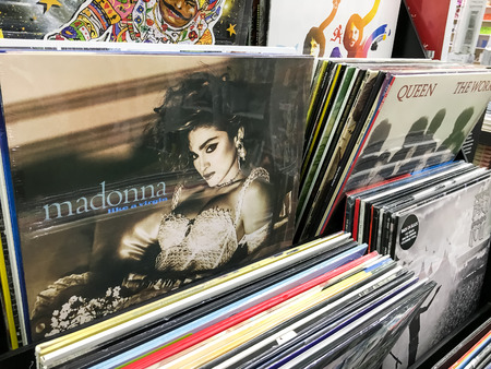 vinyl records: BUCHAREST, ROMANIA - SEPTEMBER 20, 2016: Vinyl Records Featuring Famous Rock Music For Sale In Music Media Shop.