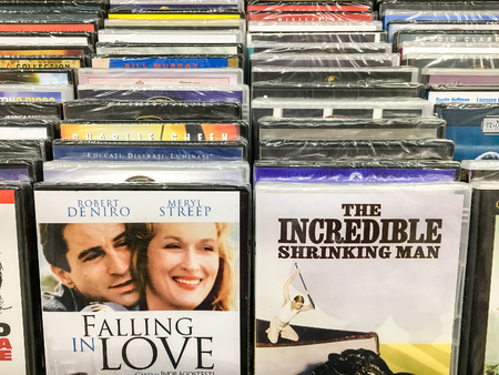 entertainment center: BUCHAREST, ROMANIA - SEPTEMBER 20, 2016: Classic And New Hollywood Production Movies On Dvd For Sale In Entertainment Center. Editorial