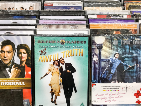 BUCHAREST, ROMANIA - SEPTEMBER 20, 2016: Classic And New Hollywood Production Movies On Dvd For Sale In Entertainment Center. Editorial