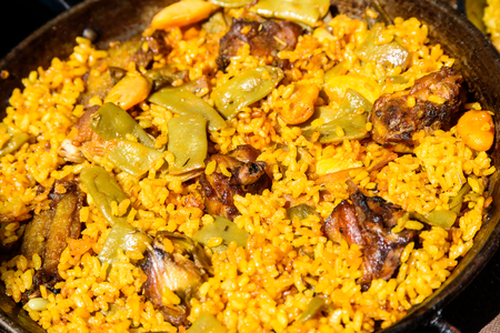 valencian: Traditional Valencian Paella With Rice And Chicken Stock Photo