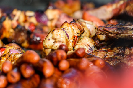 Sausages And Skewer On Barbecue Grill