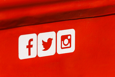 BUCHAREST, ROMANIA - SEPTEMBER 11, 2016: Facebook, Twitter and Instagram Social Media Icons on Red Metal Background.