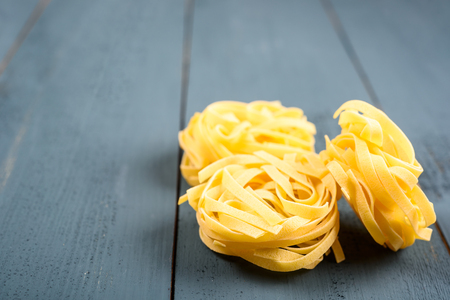 Italian Tagliatelle Pasta On Wood Table Stock Photo