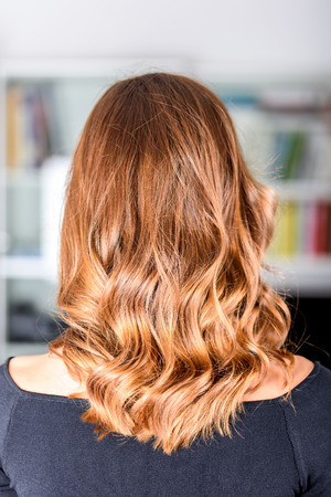 Honey Balayage Hair On Young Woman