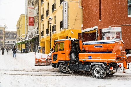 BUCHAREST, ROMANIA - JANUARY 06, 2017: Worker Snow Plow Truck During Heavy Snow Storm In Downtown Bucharest City.