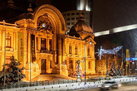 BUCHAREST, ROMANIA - JANUARY 06, 2017: CEC Bank (Casa de Economii si Consemnatiuni) During Winter Snow Storm In Downtown Bucharest At Night.