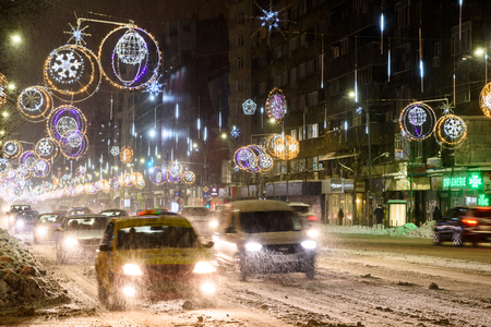 BUCHAREST, ROMANIA - JANUARY 08, 2017: Hard Traffic During Winter Snow Storm In Downtown Bucharest City.