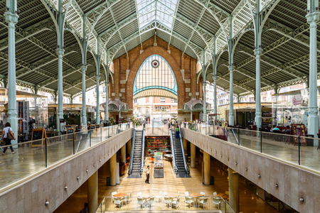 rehabilitated: VALENCIA, SPAIN - JULY 27, 2016: From 1916 Mercado Colon is an old market located in the city of Valencia now rehabilitated and equipped with shops and modern restaurants.
